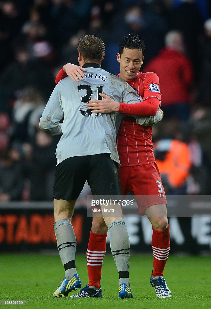 Maya Yoshida of Southampton celebrates victory with Artur Boruc of Southampton during the Barclays Premier League match between Southampton and Liverpool at St Mary's Stadium on March 16, 2013 in Southampton, England.