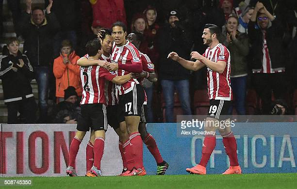 Maya Yoshida of Southampton celebrates with team mates as he scores their first goal during the Barclays Premier League match between Southampton and...