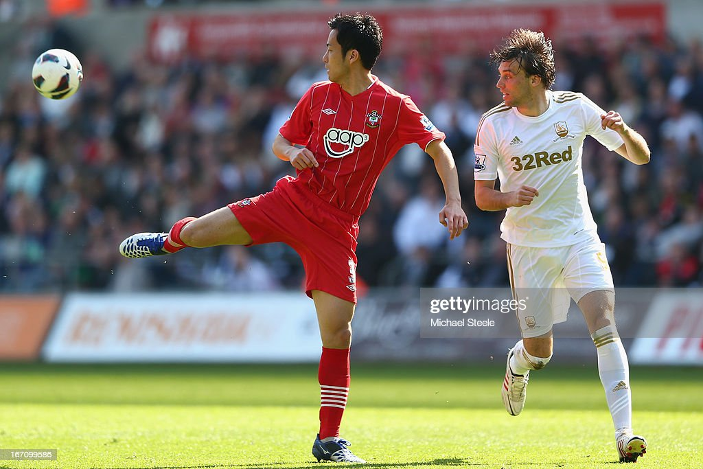 <a gi-track='captionPersonalityLinkClicked' href=/galleries/search?phrase=Maya+Yoshida&family=editorial&specificpeople=5398323 ng-click='$event.stopPropagation()'>Maya Yoshida</a> (L) of Southampton clears from Michu (R) of Swansea City during the Barclays Premier League match between Swansea City and Southampton at the Liberty Stadium on April 20, 2013 in Swansea, Wales.