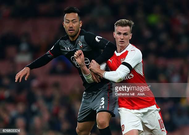 Maya Yoshida of Southampton grapples with Rob Holding of Arsenal during the EFL Quarter Final Cup match between Arsenal and Southampton at Emirates...