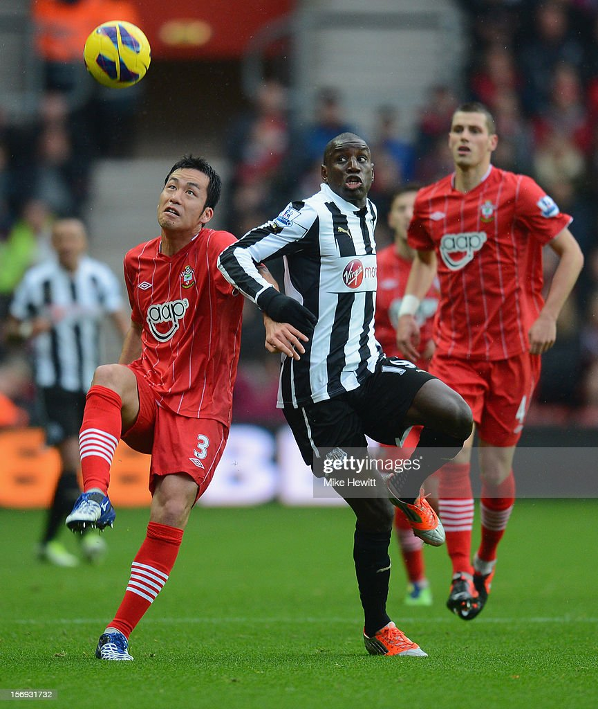 Maya Yoshida of Southampton is challenged by Demba Ba of Newcastle during the Barclays Premier League match between Southampton and Newcastle United at St Mary's Stadium on November 25, 2012 in Southampton, England.