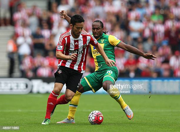 Maya Yoshida of Southampton is closed down by Cameron Jerome of Norwich City during the Barclays Premier League match between Southampton and Norwich...