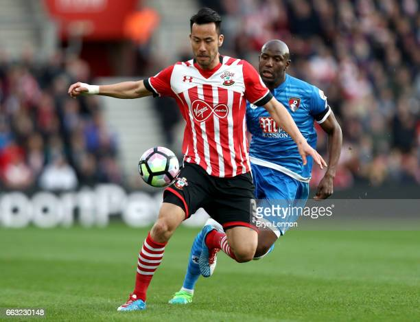 http://media.gettyimages.com/photos/maya-yoshida-of-southampton-is-put-under-pressure-from-benik-afobe-of-picture-id663230148?s=612x612