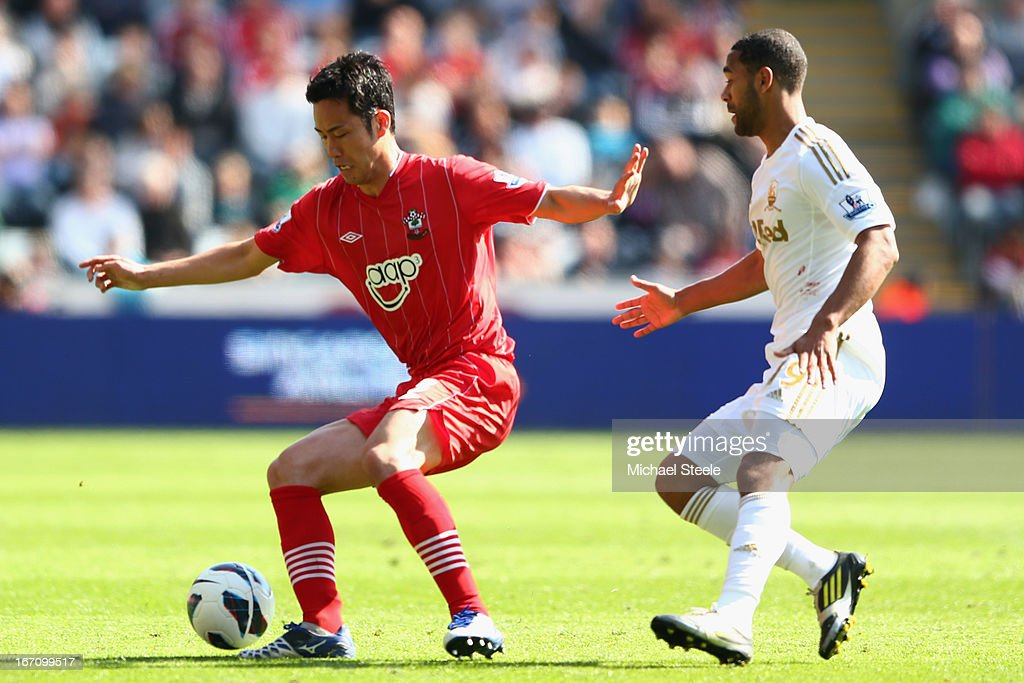 <a gi-track='captionPersonalityLinkClicked' href=/galleries/search?phrase=Maya+Yoshida&family=editorial&specificpeople=5398323 ng-click='$event.stopPropagation()'>Maya Yoshida</a> (L) of Southampton is shadowed by <a gi-track='captionPersonalityLinkClicked' href=/galleries/search?phrase=Luke+Moore&family=editorial&specificpeople=211020 ng-click='$event.stopPropagation()'>Luke Moore</a> (R) of Swansea City during the Barclays Premier League match between Swansea City and Southampton at the Liberty Stadium on April 20, 2013 in Swansea, Wales.