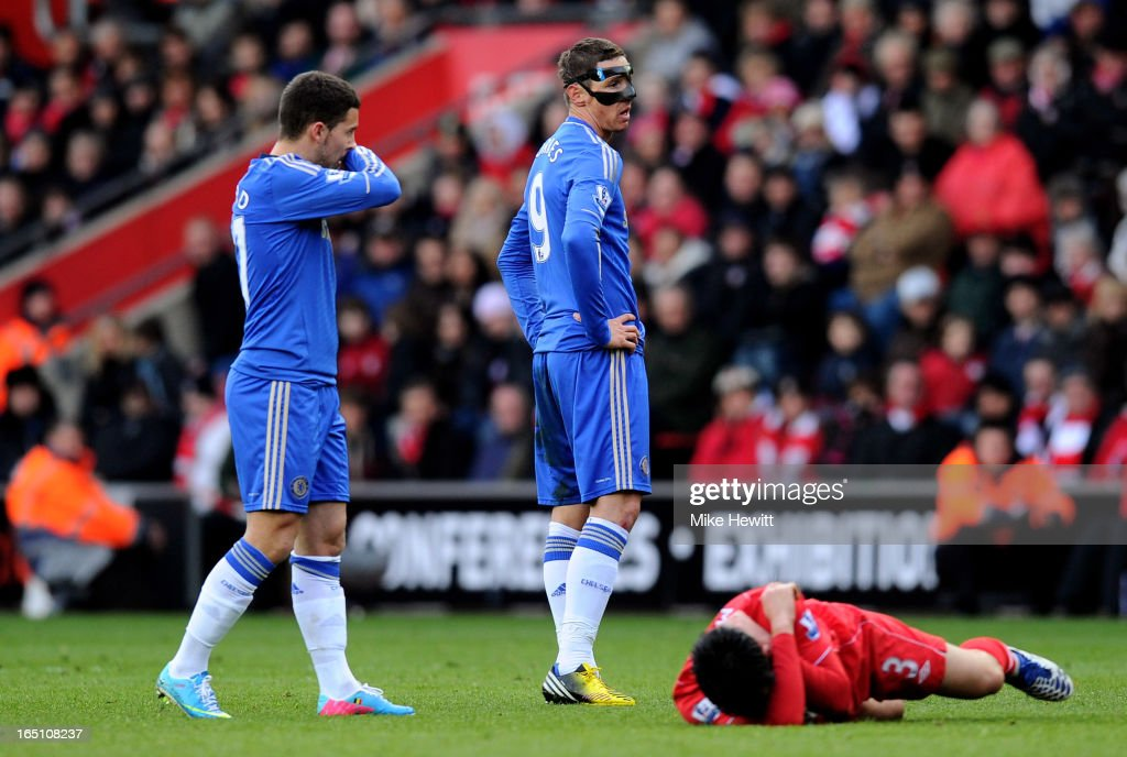 Maya Yoshida of Southampton lies injured after being fouled by Fernando Torres #9 of Chelsea during the Barclays Premier League match between Southampton and Chelsea at St Mary's Stadium on March 30, 2013 in Southampton, England.