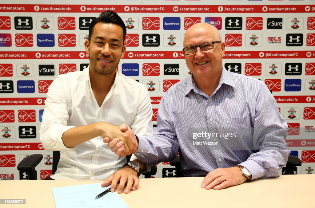 Maya Yoshida of Southampton poses with director Les Reed after signing a new contract at the Staplewood Campus on August 24, 2017 in Southampton, England.