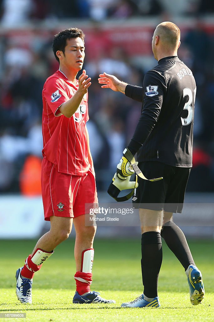 Maya Yoshida (L) of Southampton shakes hands with goalkeeper Artur Boruc (R) after their sides 0- draw during the Barclays Premier League match between Swansea City and Southampton at the Liberty Stadium on April 20, 2013 in Swansea, Wales.