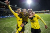 Maya Yoshida Youssef El Akchaoui and Robert Cullen celebrate victory after the Eredivisie match between VVVVenlo and NAC Breda at the Koel on...
