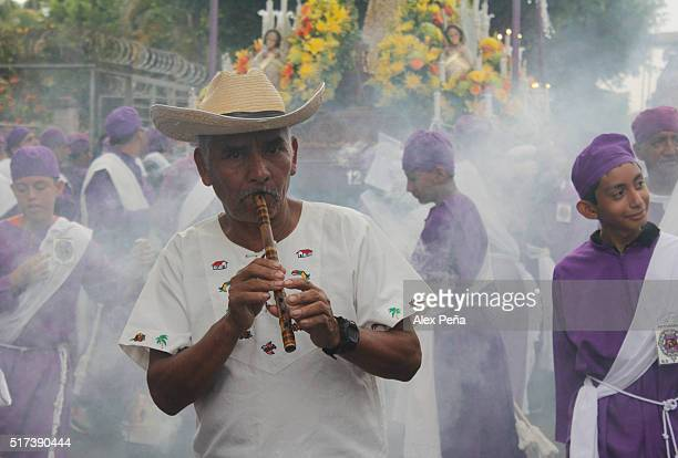 Mayan indigenous plays the flute during The Procession of the Christs on March 24 2016 in Izalco El Salvador This procession is considered the...