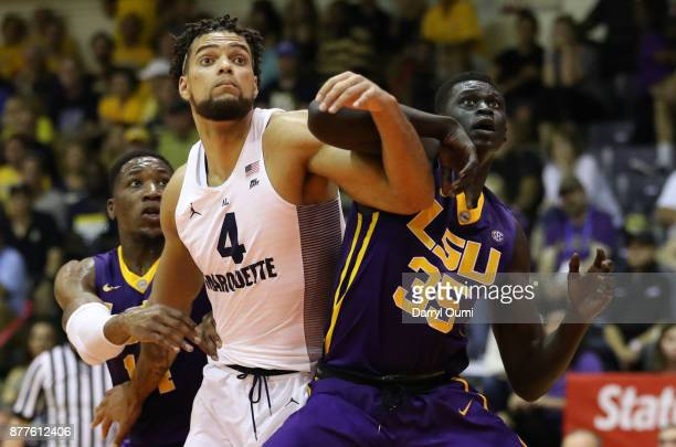 Mayan Kiir of the LSU Tigers and Theo John of the Marquette Golden Eagles battle for position during a free throw during the first half of their game...