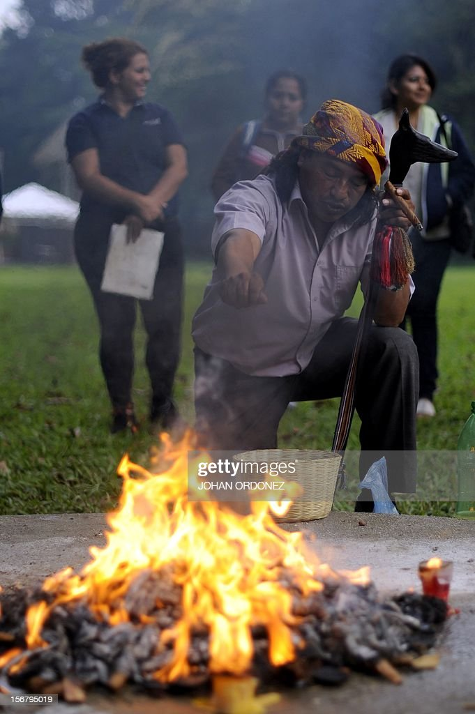 Mayan shaman performs a ritual at the Quirigua archaeological site, Izabal department, 210 km north of Guatemala City on November 21, 2012. Ceremonies will be held here to celebrate the end of the Mayan cycle known as Bak'tun 13 and the start of the new Maya Era on December 21. The Mayan calendar has 18 months of 20 days each plus a sacred month, 'Wayeb,' with five days. 'B'aktun' is the largest unit in the time-cycle system, and is about 400 years. The broader era spans 13 B'aktun, or about 5,200 years. AFP PHOTO/Johan ORDONEZ