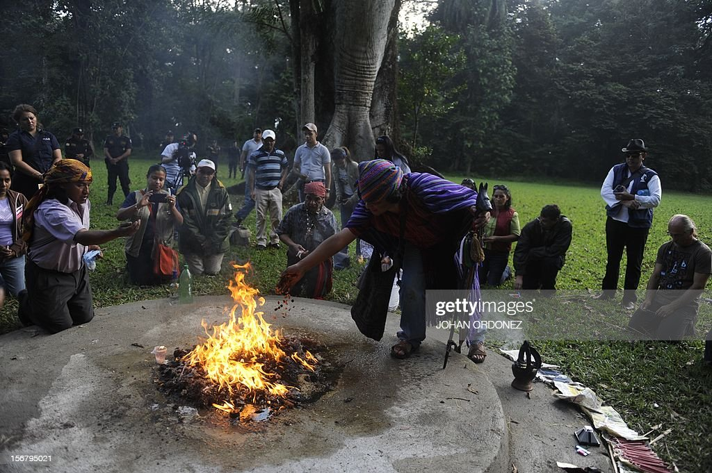 Mayan shamans perform a ritual at the Quirigua archaeological site, Izabal department, 210 km north of Guatemala City on November 21, 2012. Ceremonies will be held here to celebrate the end of the Mayan cycle known as Bak'tun 13 and the start of the new Maya Era on December 21. The Mayan calendar has 18 months of 20 days each plus a sacred month, 'Wayeb,' with five days. 'B'aktun' is the largest unit in the time-cycle system, and is about 400 years. The broader era spans 13 B'aktun, or about 5,200 years. AFP PHOTO/Johan ORDONEZ