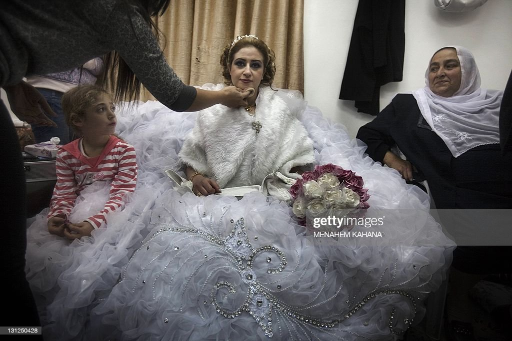 Mayanda Abud a 27yearold Syrian Druze bride from Damascus prepares for her wedding ceremony after she crossed the SyrianIsraeli border pass of...