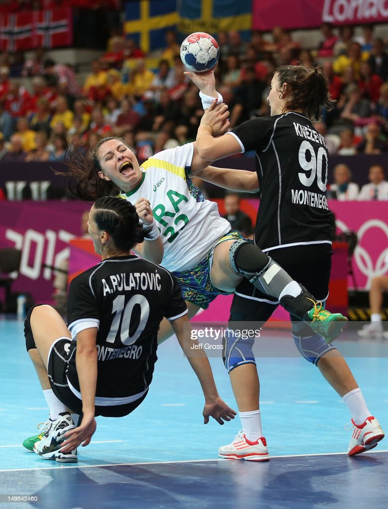 Mayara Moura of Brazil is fouled by Milena Knezevic of Montenegro in the first half during the Women's Handball Preliminaries Group A - Match 11 between Brazil and Montenegro on Day 3 of the London 2012 Olympic Games at the Copper Box on July 30, 2012 in London, England.