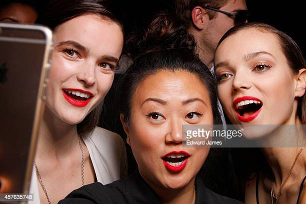 Maybelline lead makeup stylist Grace Lee takes a selfie backstage at the Target Spring/Summer 2015 fashion show during World Mastercard Fashion Week...