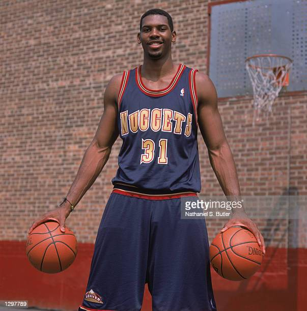 Maybyner 'Nene' Hilario of the Denver Nuggets poses for a portrait during the 2002 NBA Rookie Saturday on August 3 2002 at St Peter's Prep School in...