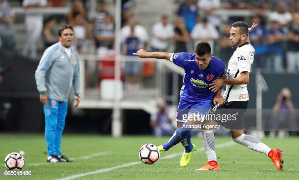 Maycon of Brazil's Corinthians vies for the ball with Gonzalo Espinoza of Chile's Universidad during the Copa Sudamericana match between Corinthians...