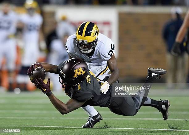 Maye of the Minnesota Golden Gophers makes a catch against Jourdan Lewis of the Michigan Wolverines during the fourth quarter of the game on October...