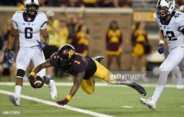 Maye of the Minnesota Golden Gophers scores a touchdown as Kenny Iloka and Ty Summers of the TCU Horned Frogs look on during the fourth quarter of...