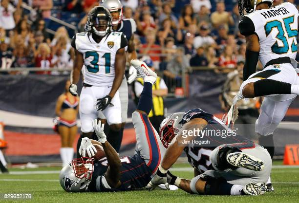 J Maye of the New England Patriots scores in the second half during a preseason game with the Jacksonville Jaguars at Gillette Stadium on August 10...