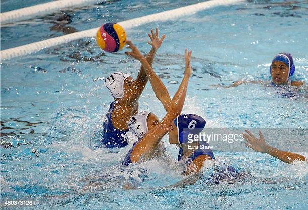 Mayelin Bernal of Cuba tries to score past Diana Carballo of Mexico during their women's water polo preliminary group match in the Toronto 2015 Pan...
