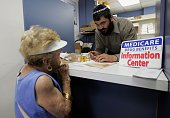 Mayer Kotlarsky owner of The Village Pharmacy store speaks with Kay Stein who has questions about the Medicare Drug Plan she signed up for May 15...