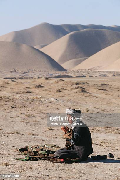 Maymana fighter allied to General Dostum praying in Herat Province during fighting against the Taliban The city of Herat was captured by the Taliban...