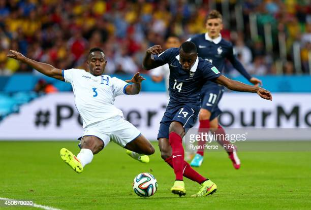 Maynor Figueroa of Honduras tries to block the shot of Blaise Matuidi of France during the 2014 FIFA World Cup Brazil Group E match between France...