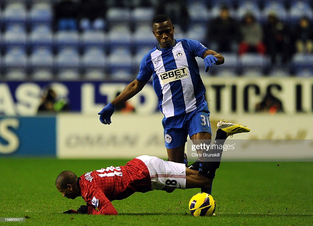 <a gi-track='captionPersonalityLinkClicked' href=/galleries/search?phrase=Maynor+Figueroa&family=editorial&specificpeople=882234 ng-click='$event.stopPropagation()'>Maynor Figueroa</a> of Wigan Athletic in action with <a gi-track='captionPersonalityLinkClicked' href=/galleries/search?phrase=Ashley+Young&family=editorial&specificpeople=623155 ng-click='$event.stopPropagation()'>Ashley Young</a> of Manchester United during the Barclays Premier League match between Wigan Athletic and Manchester United at DW Stadium on January 1, 2013 in Wigan, England.