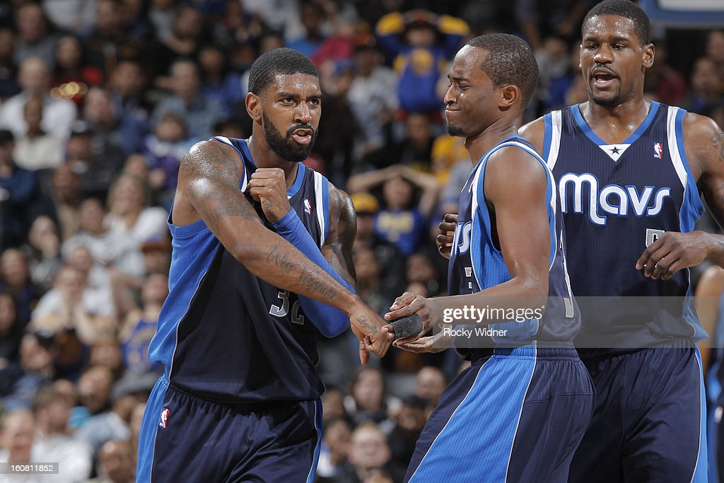 O.J. Mayo #32 of the Dallas Mavericks celebrates with teammates Rodrigue Beaubois #3 and Bernard James #5 in a game against the Golden State Warriors on January 31, 2013 at Oracle Arena in Oakland, California.