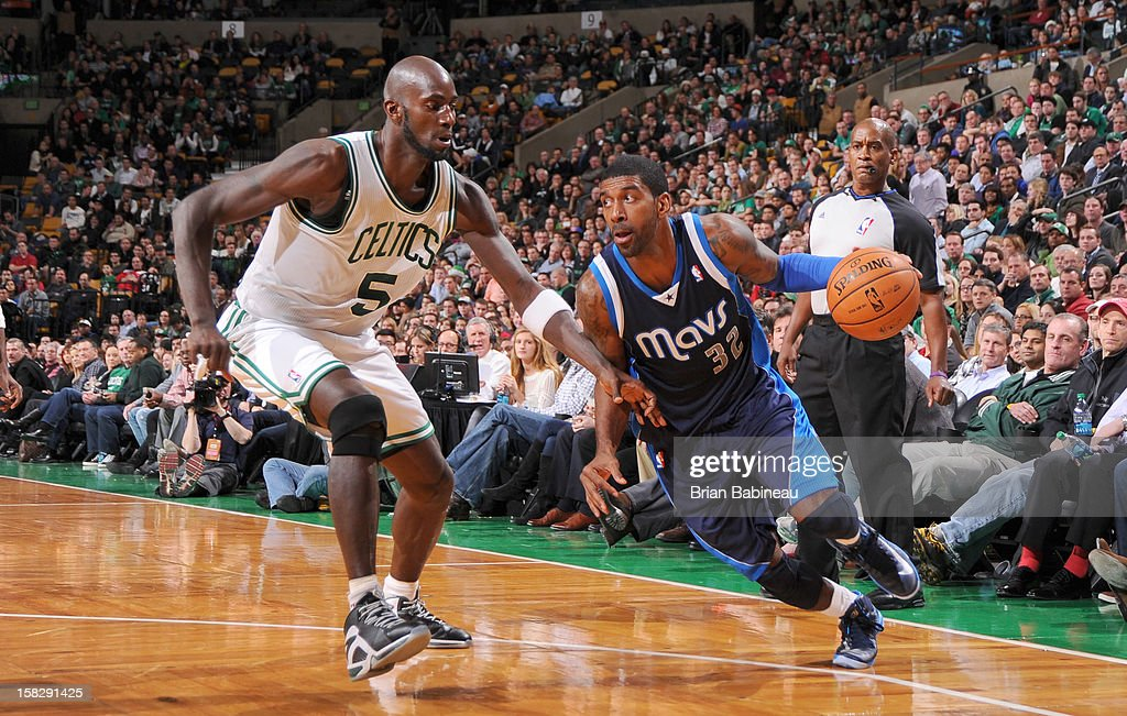 O.J. Mayo #32 of the Dallas Mavericks drives against Kevin Garnett #5 of the Boston Celtics during the game between the Boston Celtics and the Dallas Mavericks on December 12, 2012 at the TD Garden in Boston, Massachusetts.