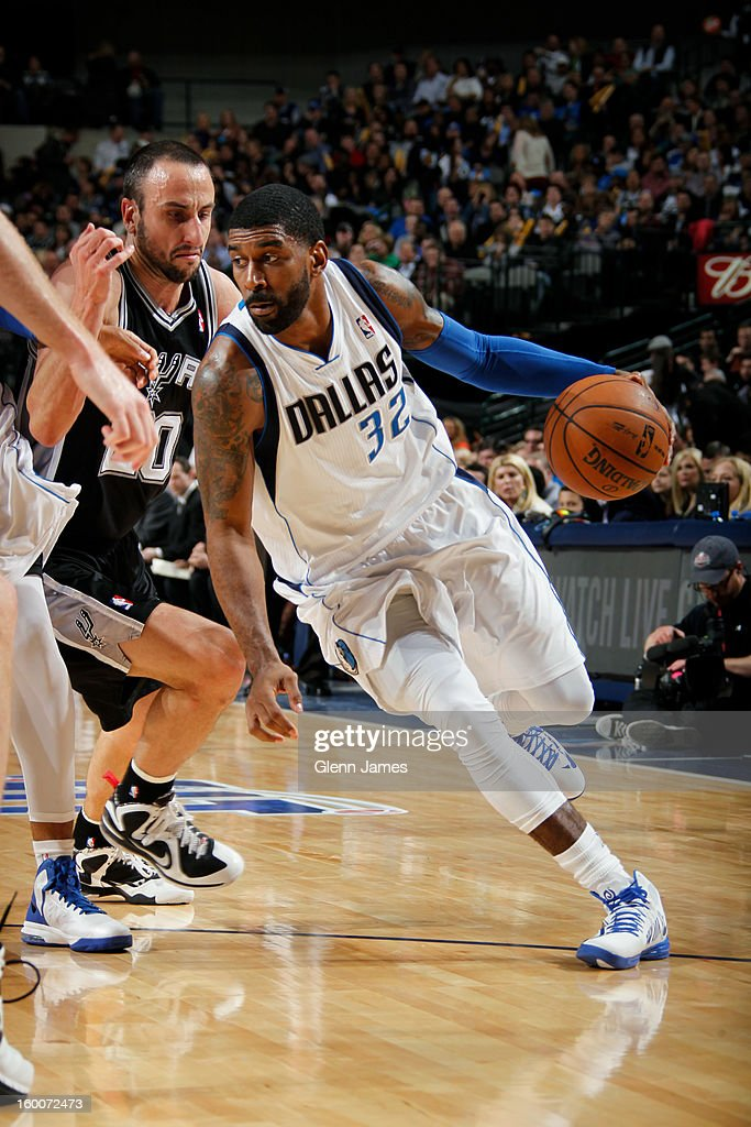 O.J. Mayo #32 of the Dallas Mavericks drives against Manu Ginobili #20 of the San Antonio Spurs on January 25, 2013 at the American Airlines Center in Dallas, Texas.