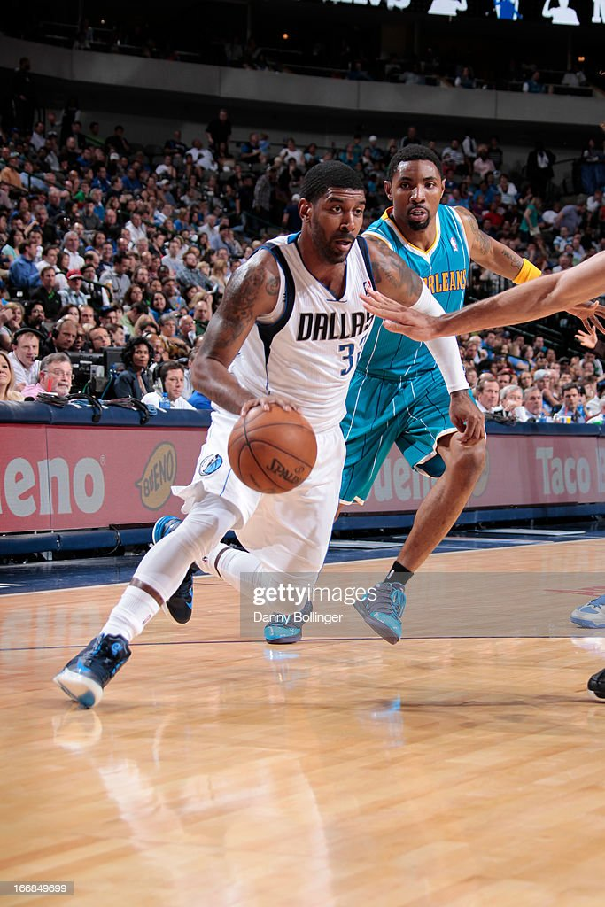 O.J. Mayo #32 of the Dallas Mavericks drives against Roger Mason Jr. #8 of the New Orleans Hornets on April 17, 2013 at the American Airlines Center in Dallas, Texas.