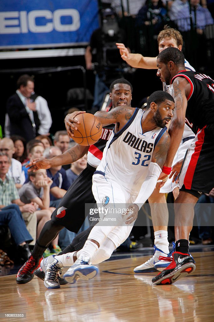 O.J. Mayo #32 of the Dallas Mavericks drives against Wesley Matthews #2 of the Portland Trail Blazers on February 6, 2013 at the American Airlines Center in Dallas, Texas.