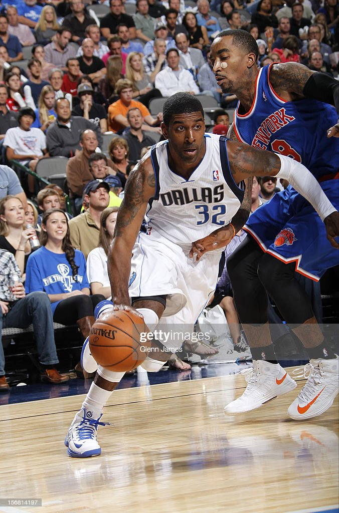 O.J. Mayo #32 of the Dallas Mavericks drives to the basket against J.R. Smith #8 of the New York Knicks on November 21, 2012 at the American Airlines Center in Dallas, Texas.