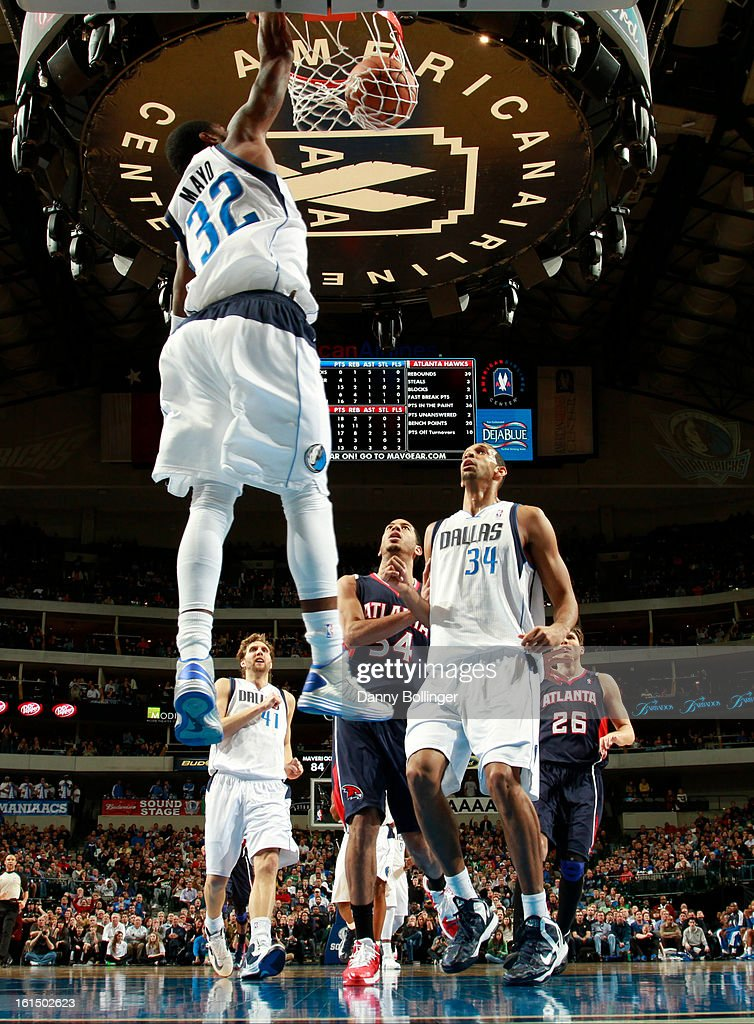 O.J. Mayo #32 of the Dallas Mavericks dunks against the Atlanta Hawks on February 11, 2013 at the American Airlines Center in Dallas, Texas.