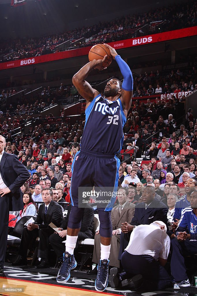 O.J. Mayo #32 of the Dallas Mavericks goes for a jump shot during the game between the Dallas Mavericks and the Portland Trail Blazers on January 29, 2013 at the Rose Garden Arena in Portland, Oregon.