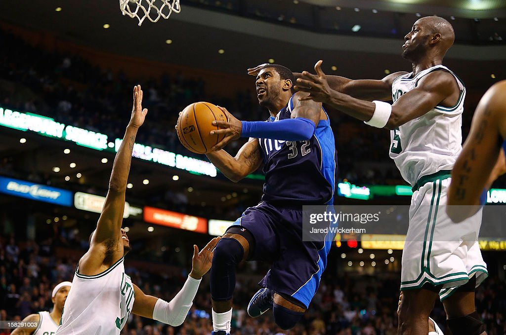 O.J. Mayo #32 of the Dallas Mavericks goes up for a layup in front of Kevin Garnett #5 of the Boston Celtics during the game on December 12, 2012 at TD Garden in Boston, Massachusetts.