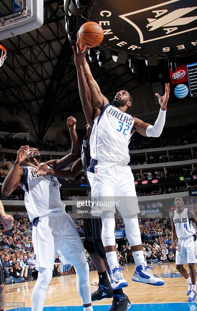 O.J. Mayo #32 of the Dallas Mavericks goes up for a rebound against the Orlando Magic on February 20, 2013 at the American Airlines Center in Dallas, Texas.