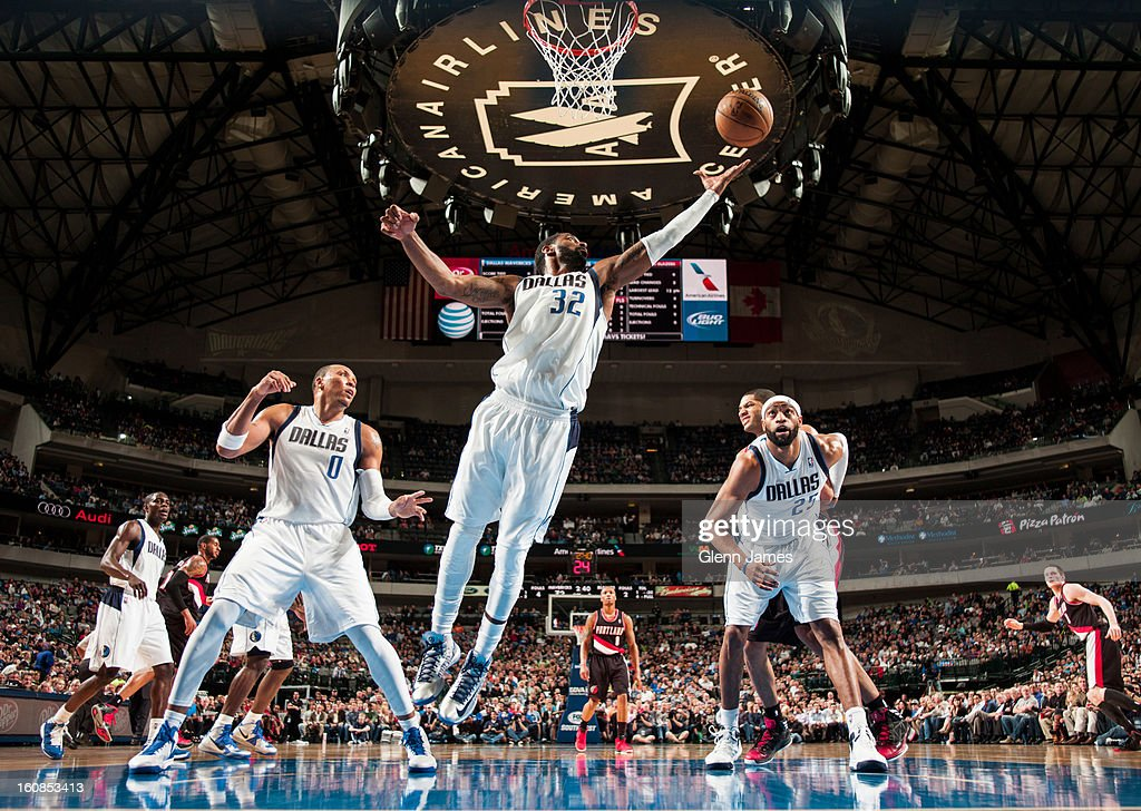 O.J. Mayo #32 of the Dallas Mavericks grabs a rebound against the Portland Trail Blazers on February 6, 2013 at the American Airlines Center in Dallas, Texas.