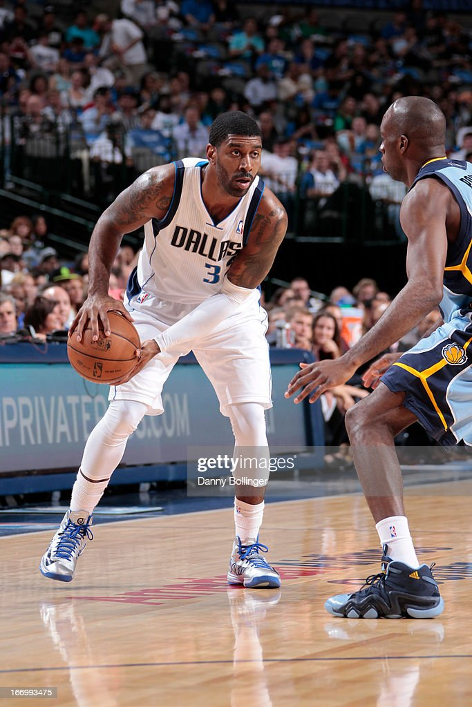 O.J. Mayo #32 of the Dallas Mavericks handles the ball against Quincy Pondexter #20 of the Memphis Grizzlies on April 15, 2013 at the American Airlines Center in Dallas, Texas.
