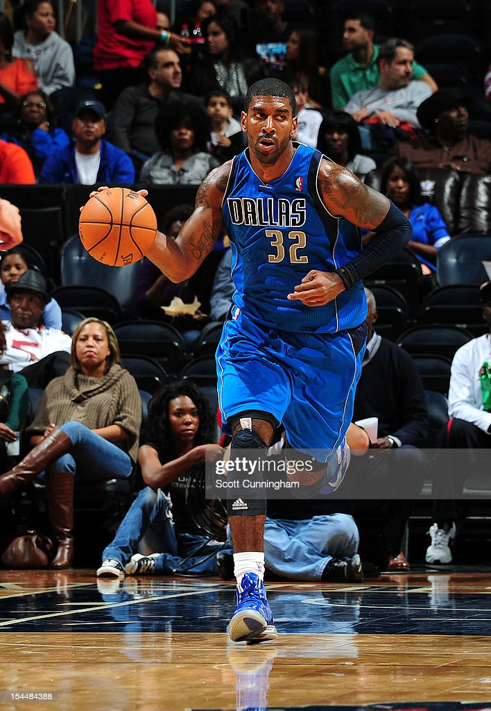 O.J. Mayo #32 of the Dallas Mavericks handles the ball against the Atlanta Hawks at Philips Arena on October 20, 2012 in Atlanta, Georgia.
