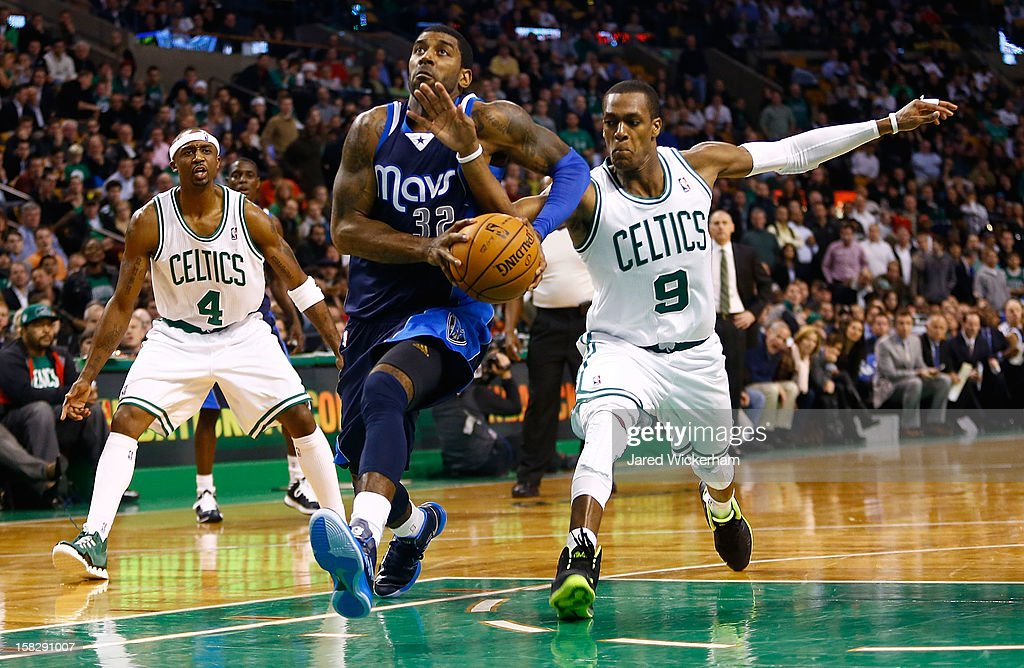 O.J. Mayo #32 of the Dallas Mavericks has the ball knocked out of his hands by Rajon Rondo #9 of the Boston Celtics in overtime during the game on December 12, 2012 at TD Garden in Boston, Massachusetts.
