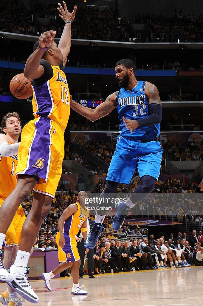 O.J. Mayo #32 of the Dallas Mavericks passes against Dwight Howard #12 of the Los Angeles Lakers at Staples Center on April 2, 2013 in Los Angeles, California.