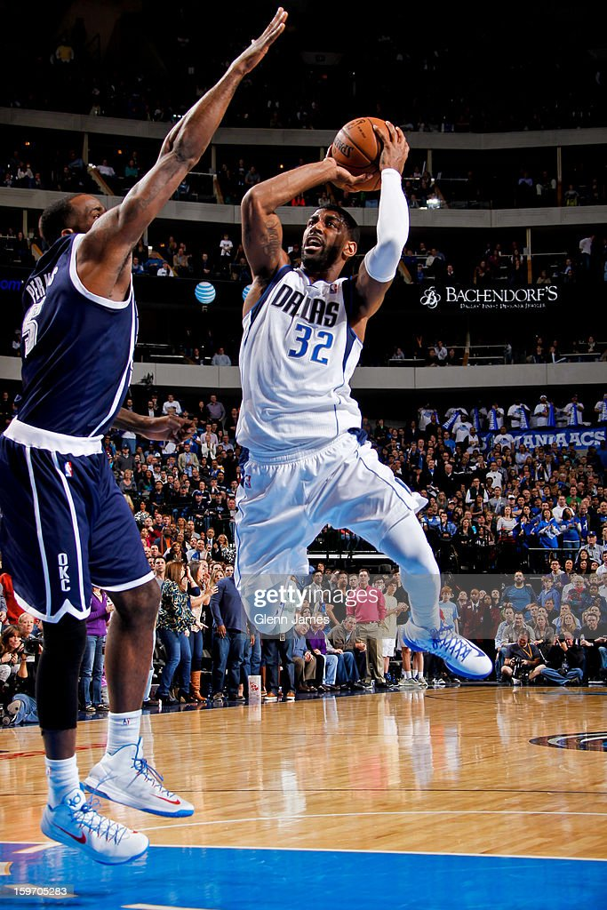 O.J. Mayo #32 of the Dallas Mavericks shoots in the lane against Kendrick Perkins #5 of the Oklahoma City Thunder on January 18, 2013 at the American Airlines Center in Dallas, Texas.