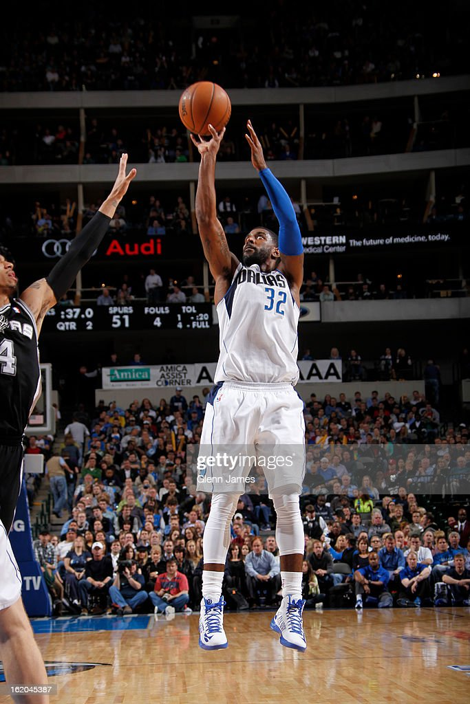 O.J. Mayo #32 of the Dallas Mavericks takes a shot against the San Antonio Spurs on January 25, 2013 at the American Airlines Center in Dallas, Texas.