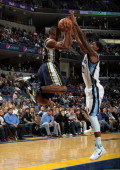 J Mayo of the Memphis Grizzlies blocks a pass attempted by Ronnie Price of the Utah Jazz on January 7 2011 at FedExForum in Memphis Tennessee NOTE TO...
