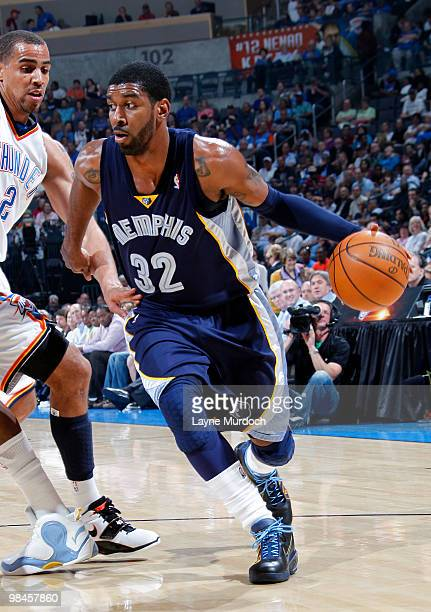 J Mayo of the Memphis Grizzlies drives past Thabo Sefolosha of the Oklahoma City Thunder on April 14 2010 at the Ford Center in Oklahoma City...