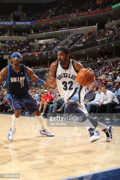 J Mayo of the Memphis Grizzlies drives to the basket against Jason Terry of the Dallas Mavericks during the game at the FedExForum on March 31 2010...