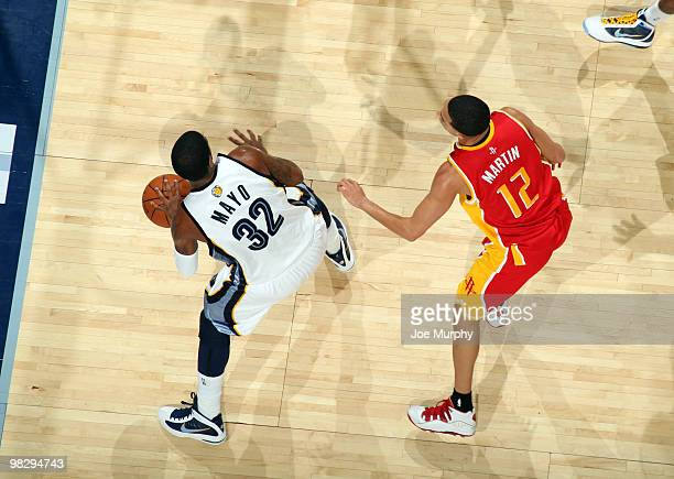 J Mayo of the Memphis Grizzlies looks to pass around Kevin Martin of the Houston Rockets on April 6 2010 at FedExForum in Memphis Tennessee NOTE TO...